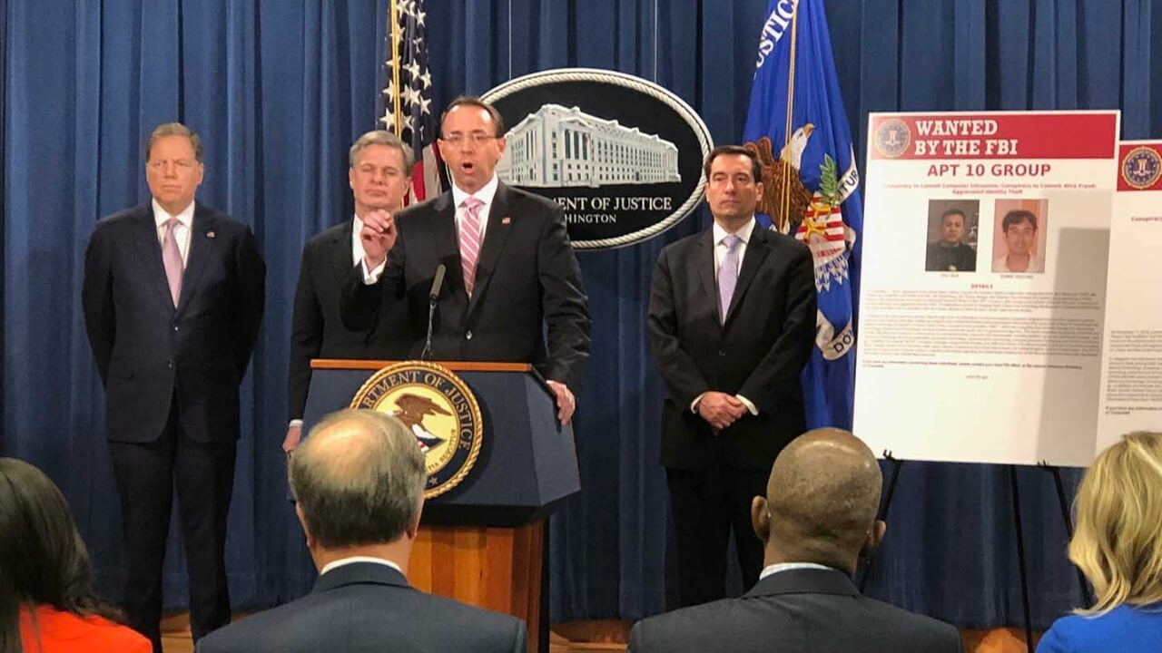 US Deputy Attorney General Rod Rosenstein (C), flanked by US law enforcement offficials, speaks at a press conference after the Justice Department unveiled fresh indictments of Chinese government hackers who allegedly targeted scores of international companies, Washington, DC, Dec. 20, 2018. RFA